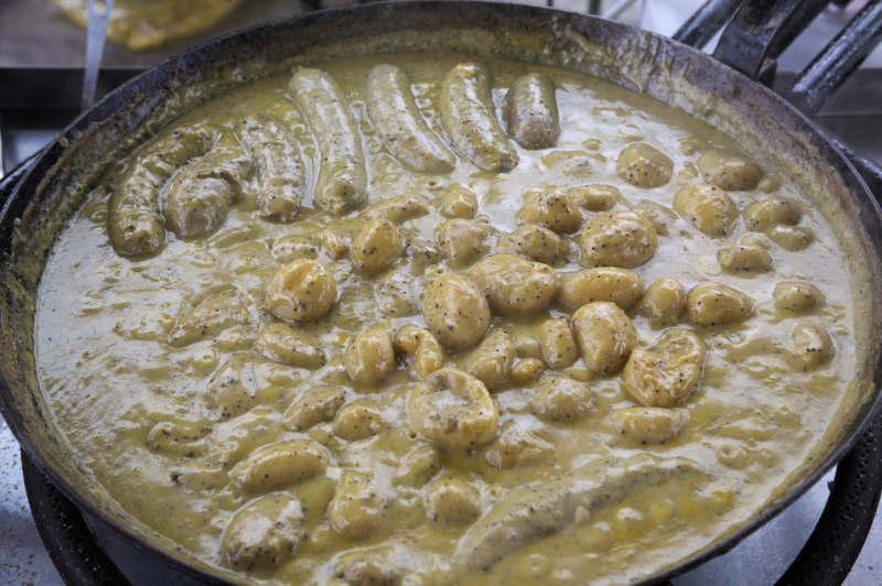 Street food: beef tripe sausage in mustard sauce